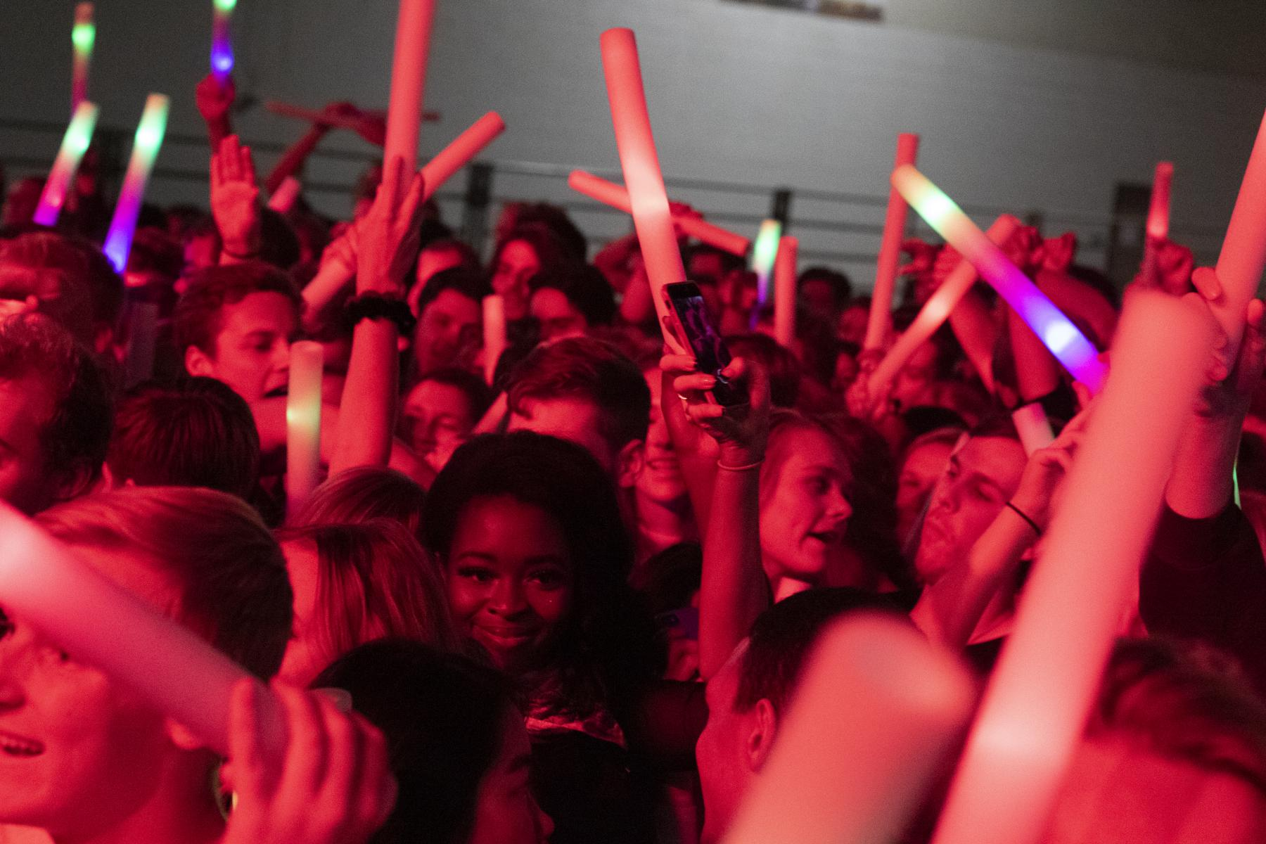 Students with glow sticks at homecoming concert